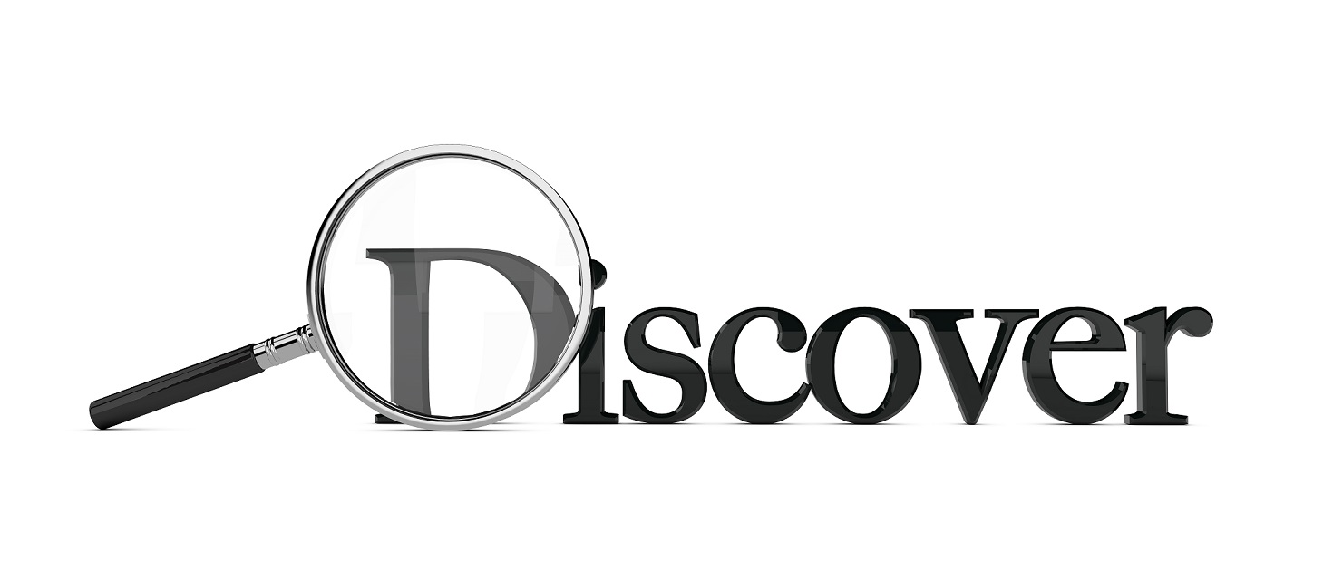 Magnifying glass enlarging the word discover